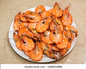 Tasty fresh spiced smoked shrimps on white plate. Asian and thai food. Hot Grill shrimps and prawns ready to eat. Delicious and healthy gourmet expensive seafood in Phuket, Thailand