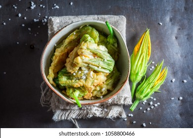 Tasty fried zucchini flower served with salt
