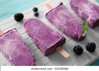 Tasty fruit ice-cream on cutting board