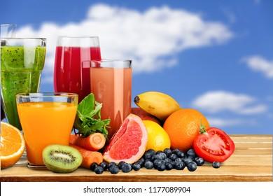 Tasty fruits and juice on desk