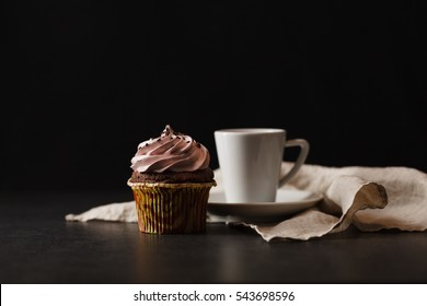 Tasty and good aroma black coffee in white cup and beautiful decorate cupcake