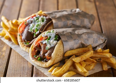 tasty greek gyros with fries with feta cheese and tzattziki sauce