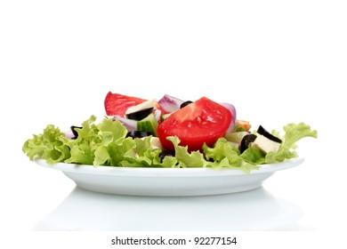 Tasty greek salad on plate isolated on white