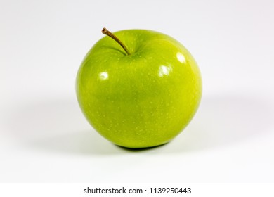 Tasty Green apples on a kitchen counter