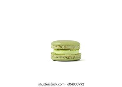 Tasty green macaron isolated on white. Various colour macarons