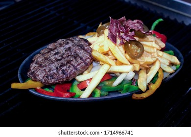 Tasty grilled beef burger with lettuce and mayonnaise AND cheese with souse