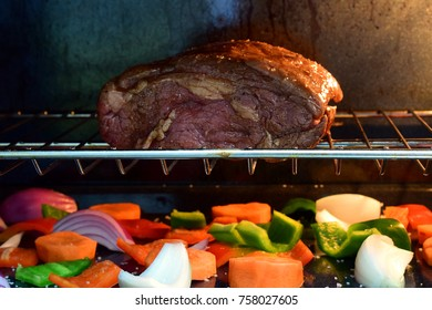 Tasty grilled meat in oven with vegetable