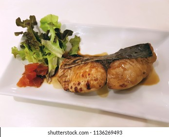 Tasty Grilled Salmon with Sweet Japanese Teriyaki Sauce on White Plate