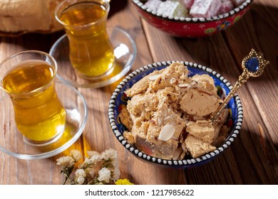 Tasty halva with tea on the table