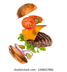 Tasty hamburger with flying ingredients on white background. High resolution image.