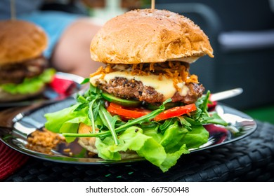 Tasty hamburger with grilled beef, cheese and vegetables