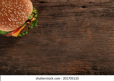 Tasty hamburger on wood background. Space for text