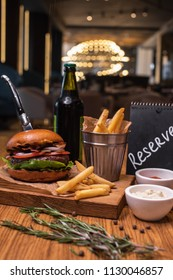 Tasty Hamburger on wooden table