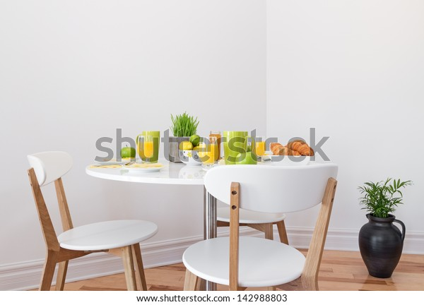 Tasty and healthy breakfast on a white round table.