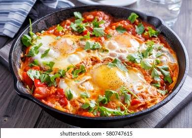 Tasty and Healthy  Shakshuka in a Frying Pan. Eggs Poached in Spicy Tomato Pepper Sauce.