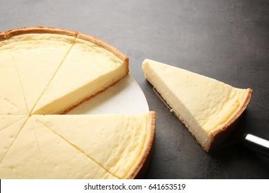 Tasty homemade cheesecake on grey table
