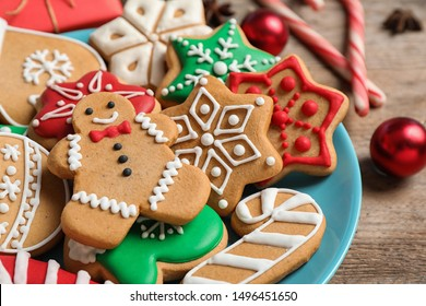 Tasty homemade Christmas cookies on blue plate, closeup view