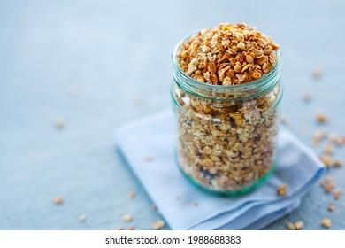 Tasty homemade fruity muesli granola in glas on bright background. Closeup - Shutterstock ID 1988688383