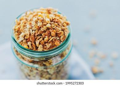 Tasty homemade fruity muesli granola in glas on bright background. Closeup - Shutterstock ID 1995272303