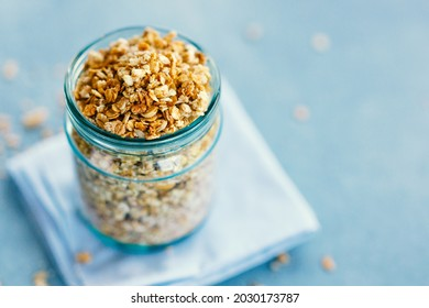 Tasty homemade fruity muesli granola in glas on bright background. Closeup - Shutterstock ID 2030173787
