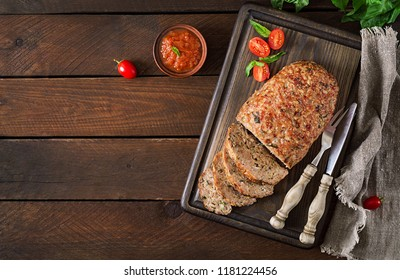 Tasty homemade ground  baked turkey meatloaf on wooden table. Food american meat loaf. Top view. Flat lay