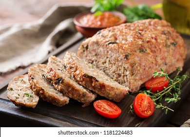 Tasty homemade ground  baked turkey meatloaf on wooden table. Food american meat loaf.