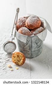 Tasty and homemade mini doughnuts with powdered sugar