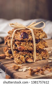 Tasty homemade oat flapjacks with nuts on a wooden board