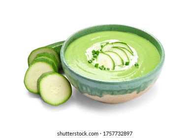 Tasty homemade zucchini cream soup isolated on white