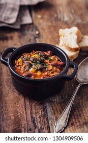 Tasty Hot Chili con carne stew with fresh herbs