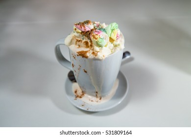 A tasty hot chocolate with lots of whipped cream and marshmallows.