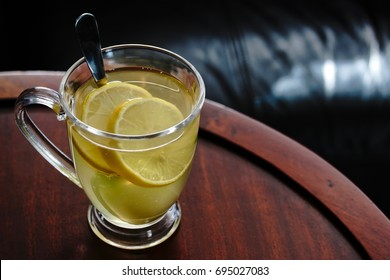 Tasty Hot Toddy With Lemon Slices In Glass Mug