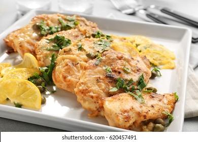 Tasty Italian chicken piccata with lemon on plate