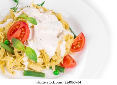 Tasty italian pasta with white sauce. Isolated on a white background.