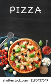 Tasty Italian pizza with ingredients on wooden background