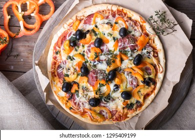 Tasty Italian pizza and its ingredients on  textured background, top view, close-up,  Delicious snack. Mediterranian cuisine. Fast food concept