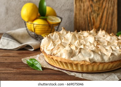 Tasty lemon meringue pie on wooden table, closeup