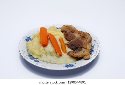 Tasty lunch on the table.Lunch background.Meat,patato an carot on a white background.Meat on a plate.