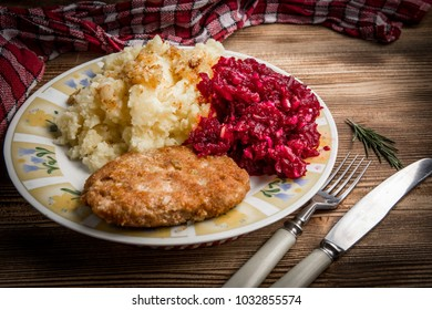 Tasty lunch: Pork cutlet with minced meat served with boiled potatoes and beetroot.