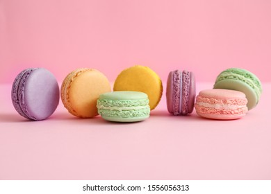 Tasty macarons on color background