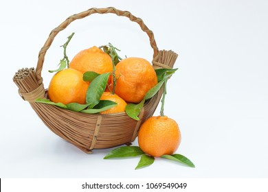 Tasty mandarins in the basket on white background