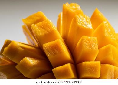 Tasty mango slices. Selective focus. Macro closeup