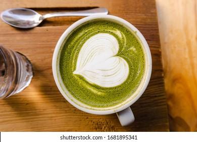 Tasty Matcha Latte with a foam Milk heart in a Lovely Barcelona coffee shop