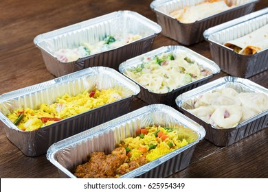 Tasty Meals In Take Away Containers On Table