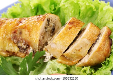 Tasty meat cutlet with garnish on plate close-up