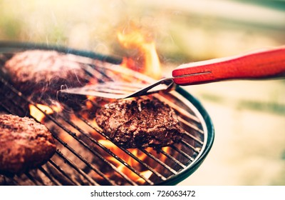 Tasty meat on the grill outdoors, preparing barbecue pork for burgers, traditional summer food cookout, good food for party outdoor