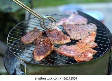Tasty meat slices on barbecue