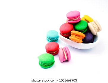 Tasty mini french macaroon cookie with blow on white backgrounds