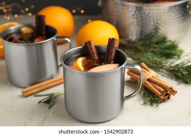 Tasty mulled wine with spices on light table