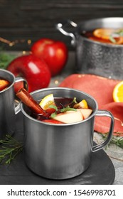Tasty mulled wine with spices on grey table